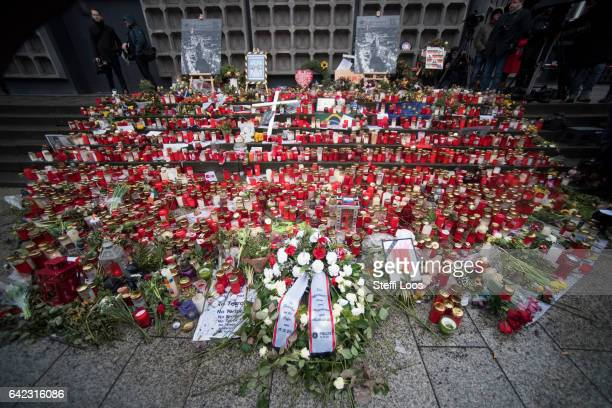 Flowers and candles lay at a memorial to the victims of the December Berlin terror attack before a visit of German Chancellor Angela Merkel and...