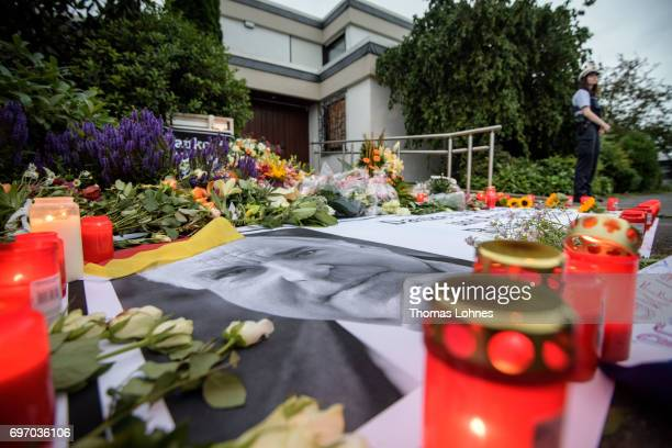 Flowers and Candles lay next to a portrait of Helmut Kohl in front of the home of former German Chancellor Helmut Kohl in Oggersheim district on June...