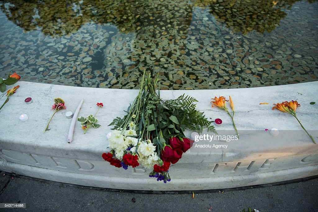 Flowers and candles placed around the fountain in Dupont Circle during a vigil for the victims of the Istanbul Airport terrorist attack Washington, USA on June 29, 2016.
