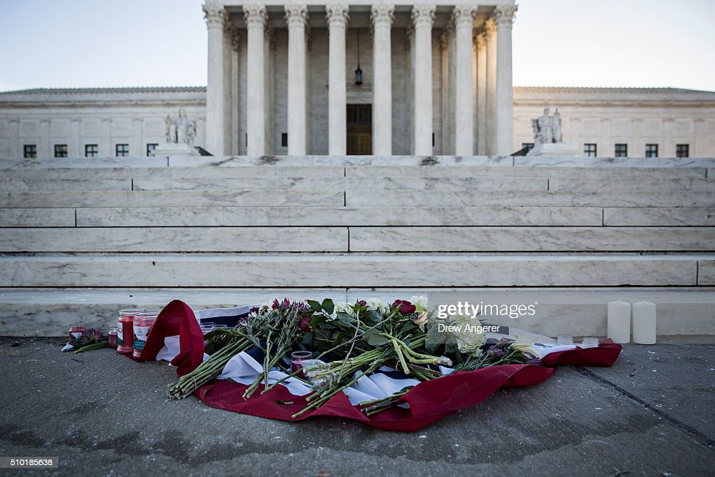 Flowers and candles sit at the bottom of the steps at the U.S. Supreme Court following the death of Supreme Court Justice Antonin Scalia February 14, 2016 in Washington, DC. Supreme Court Justice Antonin Scalia was at a Texas Ranch Saturday morning when he died at the age of 79.