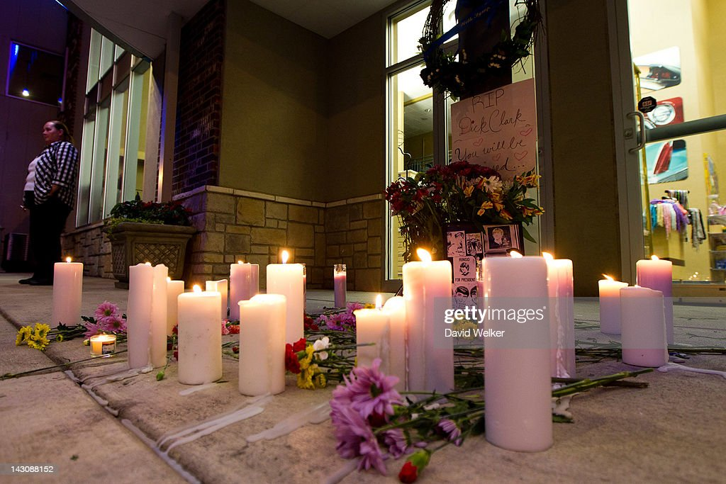 Flowers and candles were placed on the ground during a candlelight vigil in honor of Dick Clark at Dick Clark's American Bandstand Theater on April...