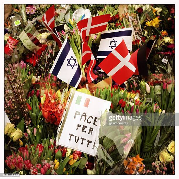 Flowers and flags in front of synagogue in Copenhagen