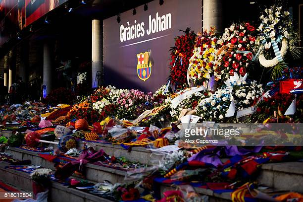 Flowers and gifts left by people to pay tribute to late Dutch football star Johan Cruyff are seen in a special condolence area set up at Camp Nou...
