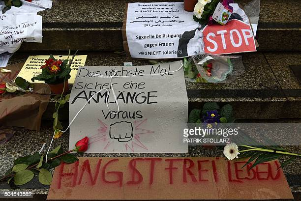 Flowers and letters of protest are laid down on the steps of the Cathedral in front of the Cologne main train station in Cologne western Germany on...