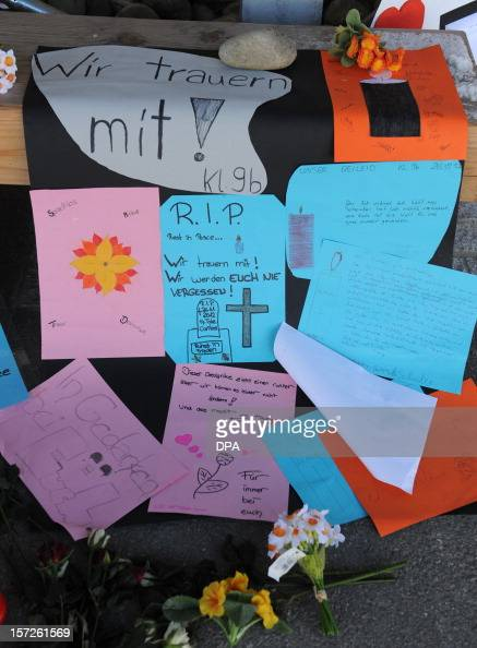 Flowers and messages are laid down in front of a workshop for disabled people in Titisee Neustadt southern Germany on December 1 2012 An oecumenical...