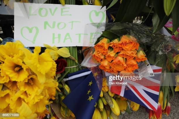 Flowers and messages are left outside the Houses of Parliament in memory of those who died in last weeks Westminster terror attack on March 27 2017...