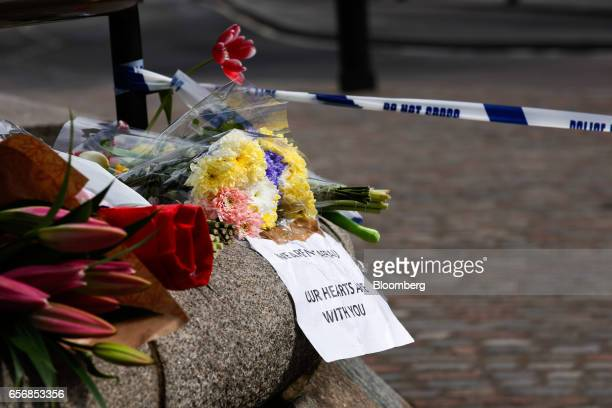 Flowers and messages sit near a police cordon outside Westminster Abbey after the terror attack at Westminster in central London UK on Thursday March...