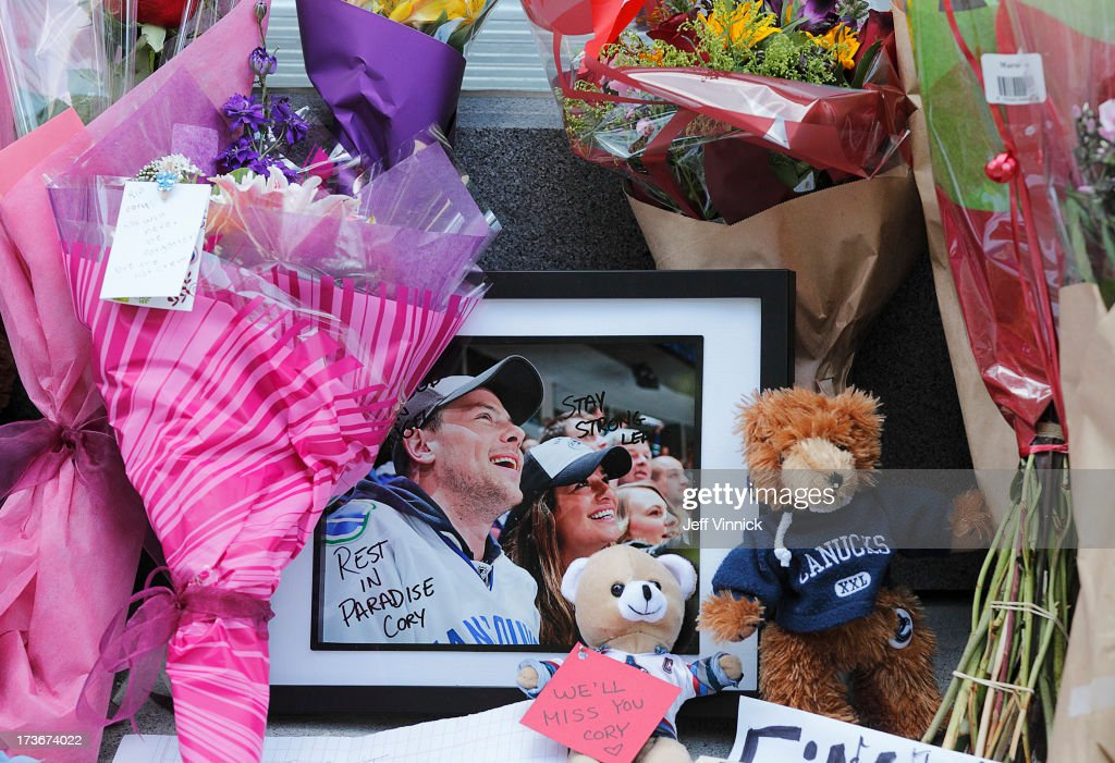 Flowers and photos left by mourning fans occupy a memorial to deceased actor Cory Monteith outside the Fairmont Pacific Rim Hotel on July 16, 2013 in Vancouver, British Columbia, Canada. The B.C. Coroners Service released results of Monteith's autopsy today and found the 31-year-old's cause of death was a mixed drug toxicity involving heroin and alcohol.