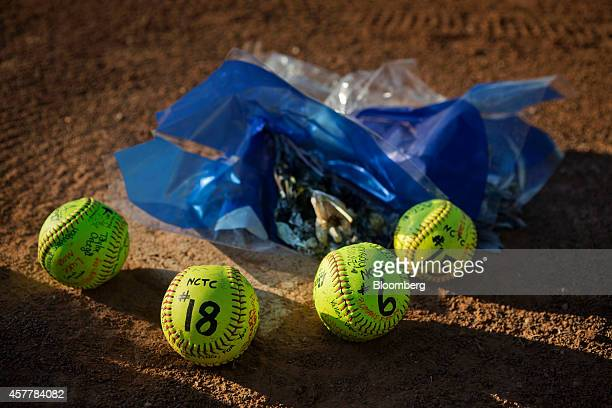 Flowers and signed softballs constitute a makeshift memorial at home plate on the North Central Texas College softball field in Gainesville Texas US...