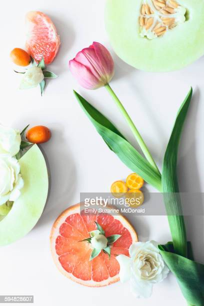 Flowers and sliced fruit