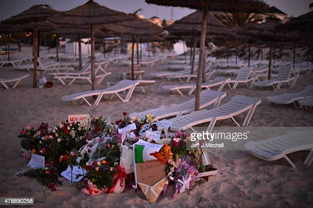 Flowers and tributes are left at Marhaba beach near to where 38 people were killed on Friday in a terrorist attack on June 28 2015 in Souuse Tunisia...