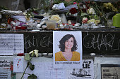 Flowers and tributes are left at the base of the Statue de Marianne at the Place de la Republique as a mark of respect to the victims of the Paris...