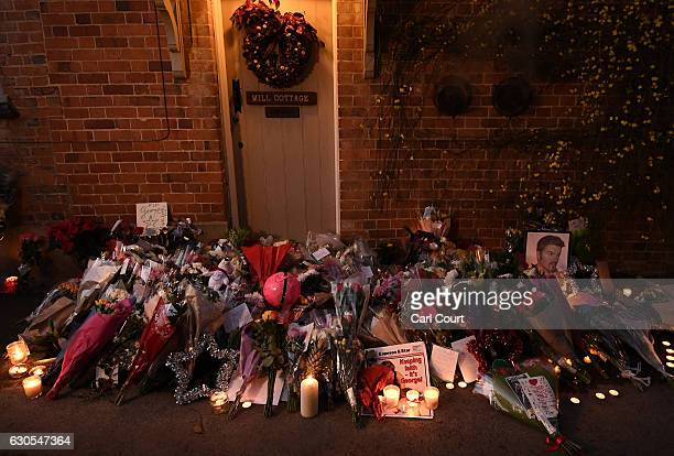 Flowers and tributes are left outside the Oxfordshire home of British pop singer George Michael on December 26 2016 in Goring England Singer George...