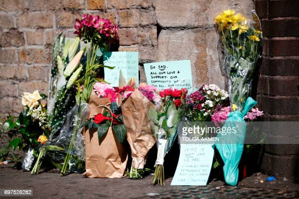Flowers and tributes are pictured at a police cordon near the scene in Finsbury Park area of north London after a vehicle was driven into pedestrians...