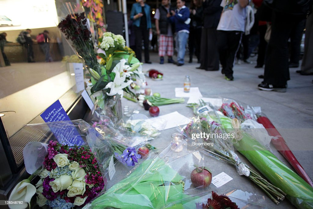 Flowers, apples and messages are left at a memorial for Steve Jobs, co-founder and former chief executive officer of Apple Inc., outside an Apple store in New York, U.S., on Thursday, Oct. 6, 2011. Jobs, who built the world's most valuable technology company by creating devices that changed how people use electronics and revolutionized the computer, music and mobile-phone industries, died on Oct. 5. He was 56. Photographer: Stephen Yang/Bloomberg via Getty Images