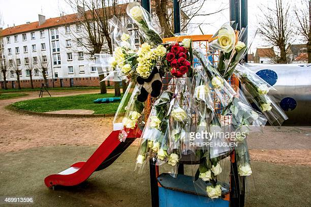 Flowers are attached to a slide at a playground on April 16 2015 in the neighborhood where Chloe a nineyearold girl who was snatched on April 15 in...