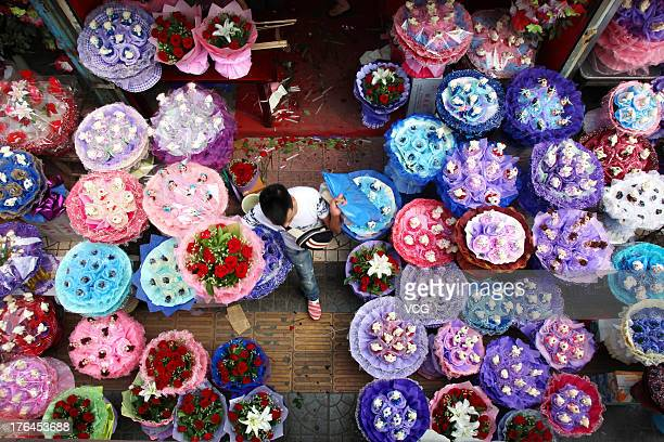 Flowers are displayed for sale at a flower store on August 13 2013 in Xi an China The Chinese Valentine's Day falls on the 7th day of the 7th month...