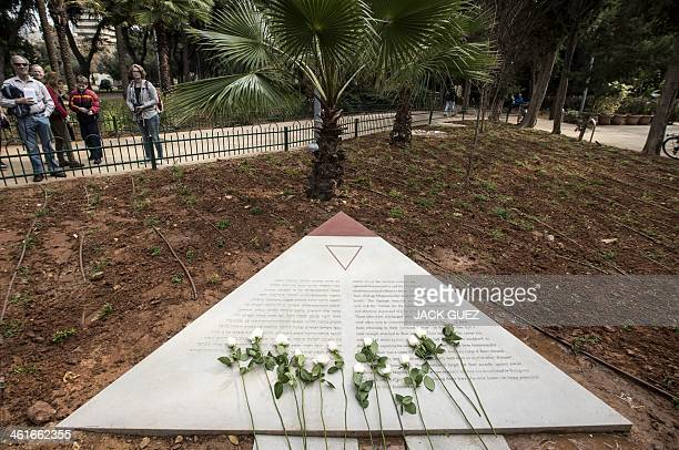 Flowers are laid at a memorial to thousands of gay Holocaust victims killed by the Nazi during the Second War at the Gan Meir during its inauguration...