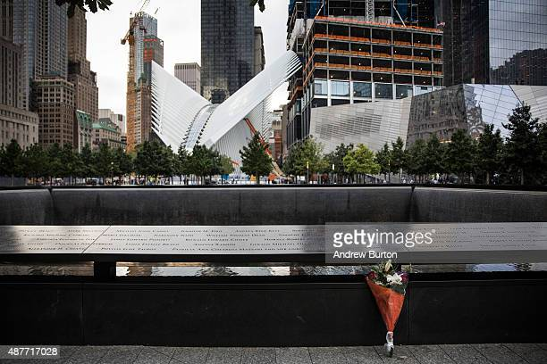 Flowers are laid at the 911 Memorial site on September 11 2015 in New York City Today marks the 14th anniversary of the attacks where nearly 3000...