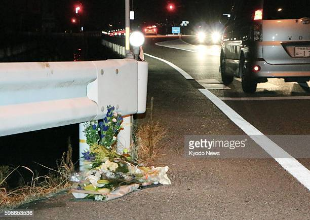 Flowers are laid in Tokushima Japan on Aug 24 near the scene where a passerby was killed in the first fatal accident in the country linked to a...