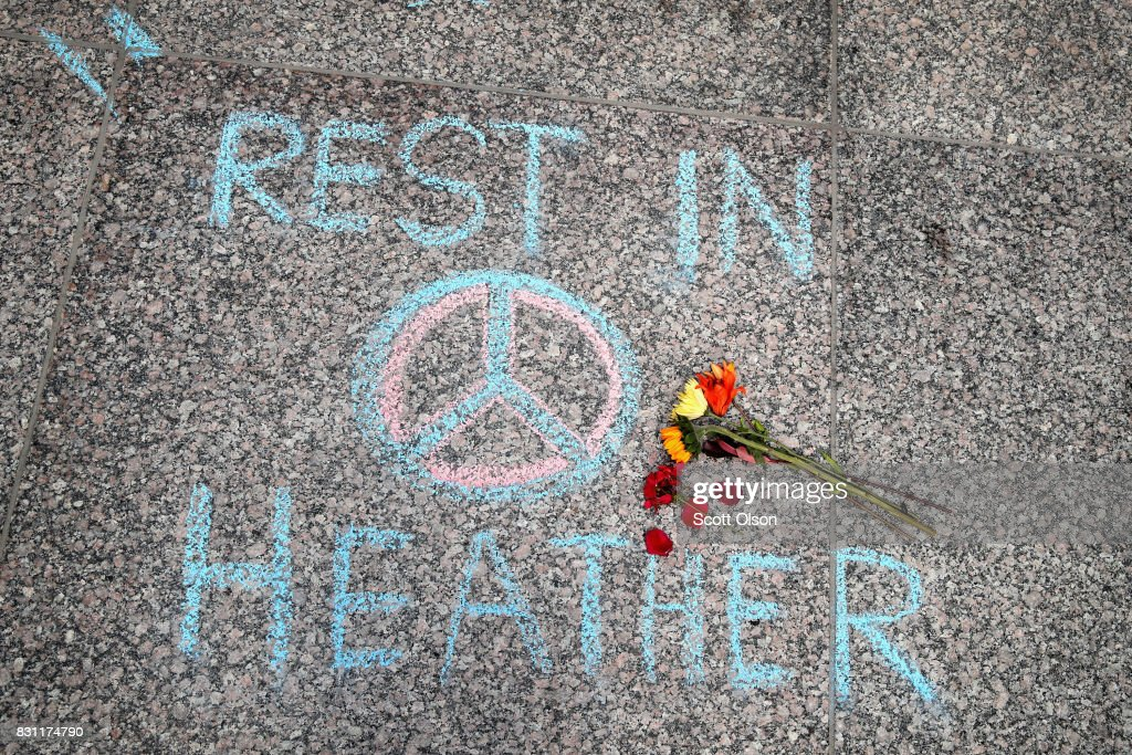 Flowers are laid on a memorial to Heather Heyer that was chalked on the pavement during a demonstration on August 13, 2017 in Chicago, Illinois. Heyer was killed and 19 others were injured yesterday in Charlottesville, Virginia when a car plowed into a group of activists who were preparing to march in opposition to a nearby white nationalist rally. Two police officers were also killed when a helicopter they were using to monitor the rally crashed.