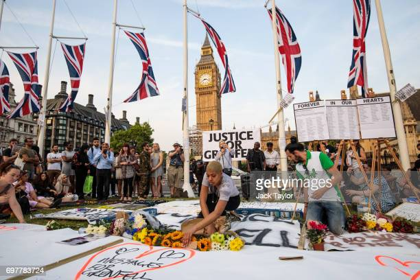 Flowers are laid out during a vigil for the victims of the Grenfell Fire disaster at Parliament Square on June 19 2017 in London England Seventynine...
