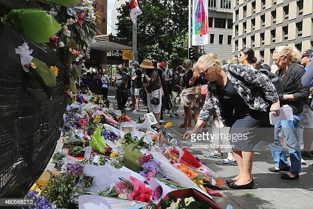 Flowers are left as a sign of respect at Martin Place on December 17 2014 in Sydney Australia Sydney siege gunman Man Haron Monis was shot dead by...