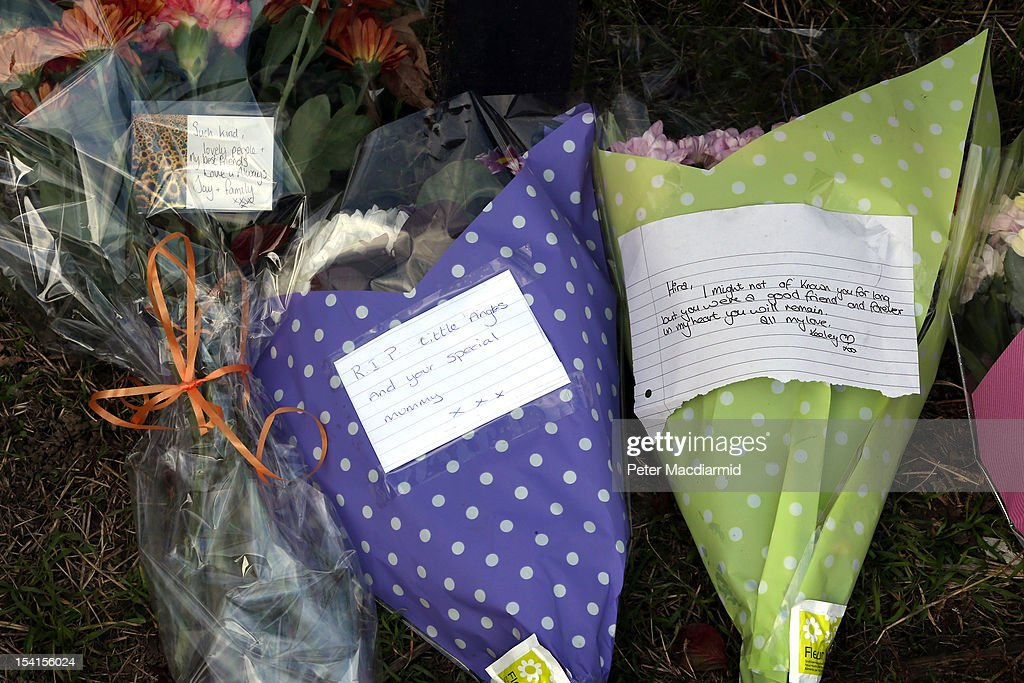Flowers are left at a road sign denoting the name of the road where a house fire killed five people on October 15, 2012 in Harlow, England. A woman and four children have died and another three are in hospital are a fire in a house on an estate near Harlow in Essex.