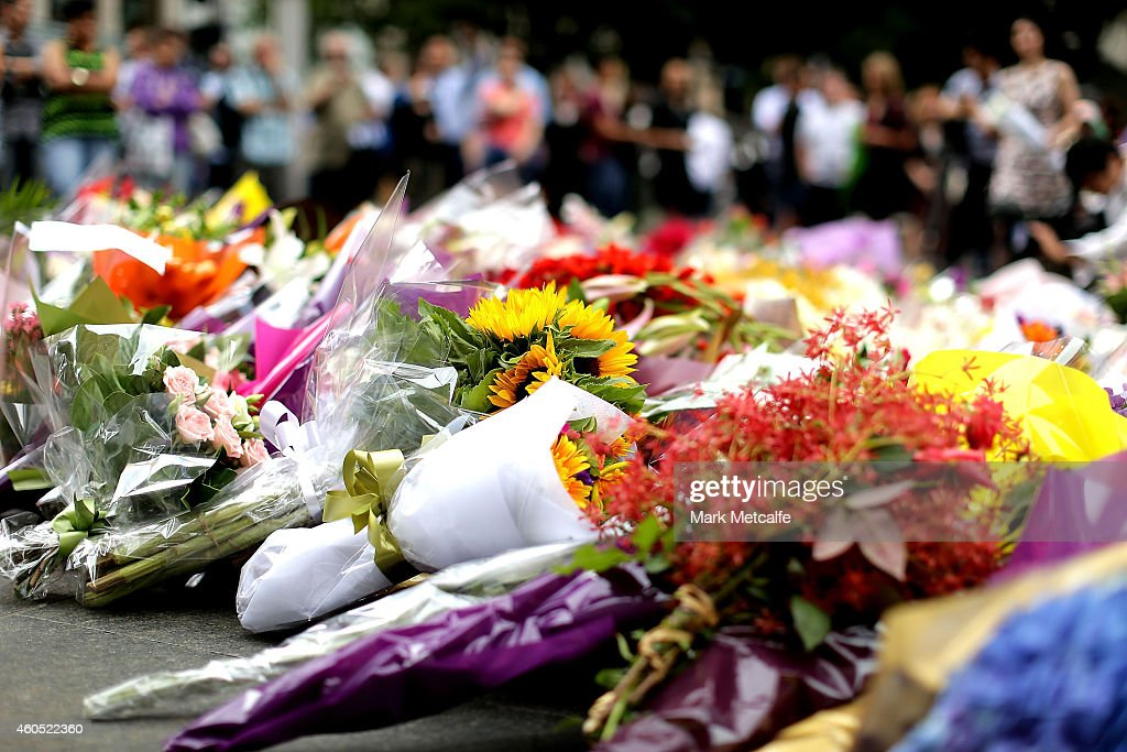 Flowers are left at Martin Place on December 16 2014 in Sydney Australia Sydney siege gunman Man Haron Monis was shot dead by police in the early...