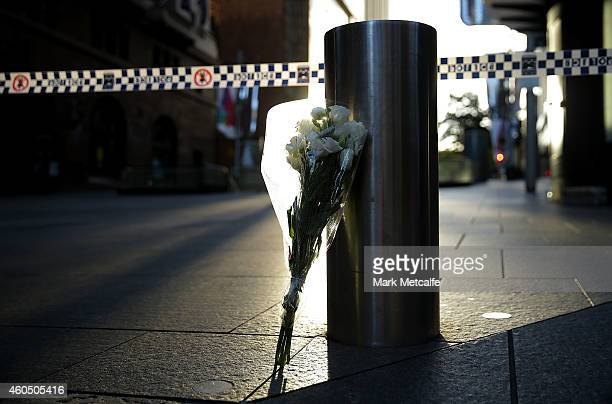 Flowers are left at Martin Place on December 16 2014 in Sydney Australia The siege in Sydney's Lindt Cafe in Martin Place is over after 16 hours...