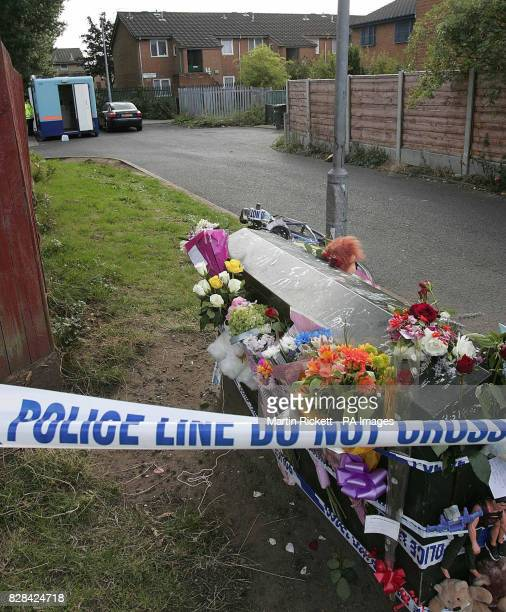 Flowers are left at Terrington Close Chorlton where a sixyearold boy was found by his father murdered in his bedroom police said Thursday 1 September...