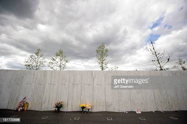 Flowers are left at the memorial wall which bears the names of 40 victims at the Flight 93 National Memorial prior to ceremonies commemorating the...