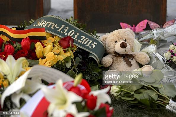 Flowers are left by people taking part in thecommemoration of the March 13 2012 Sierre bus accident on March 13 2015 in Sierre Western Switzerland...