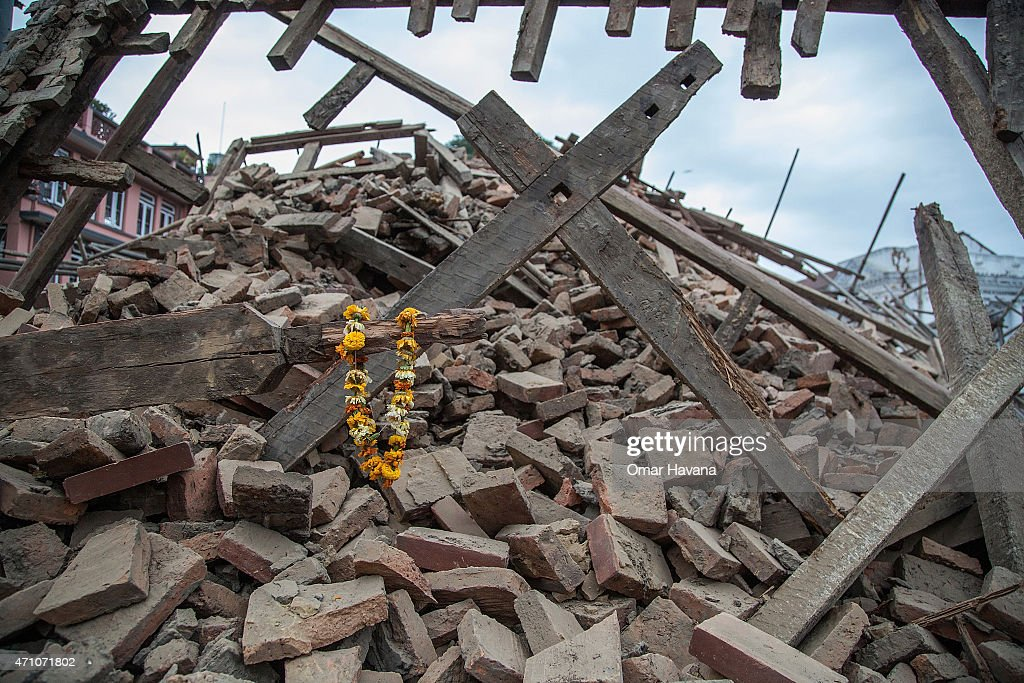 Flowers are left by survivors on top of debris from a collapsed building at Basantapur Durbar Square following an earthquake on April 25 2015 in...