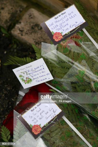 Flowers are left in an alleyway behind the beer garden of The New Inn public House on Myrtle Road in Sutton south London where a 28yearold man was...