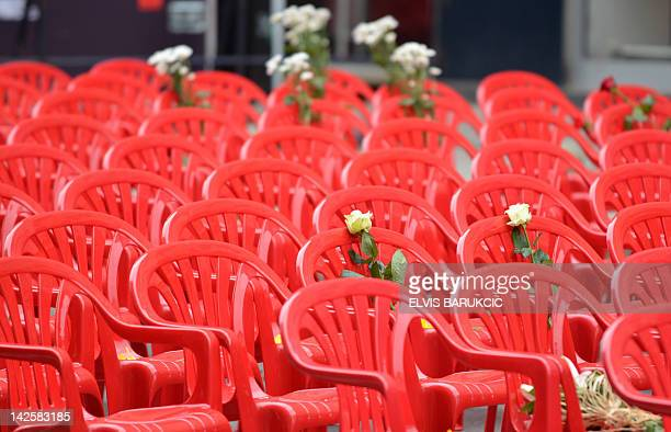 Flowers are left on chairs lined up along the main street in Sarajevo on April 6 to mark the 20th anniversary of the bloodiest conflict in Europe...