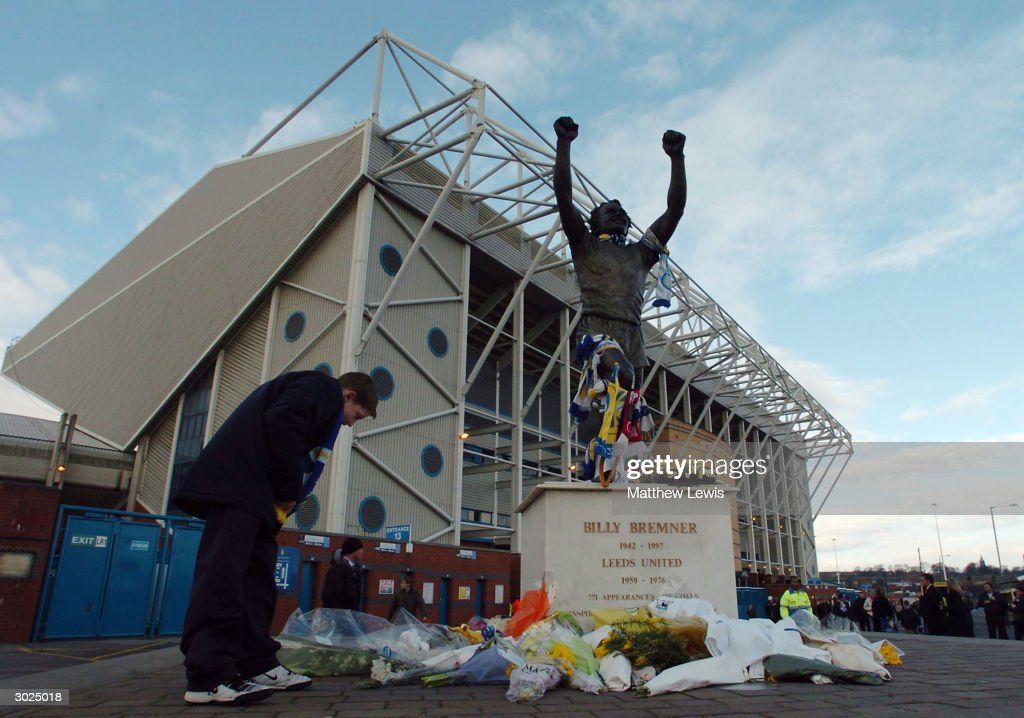Flowers are left on the Billy Bremner statue in memory of former player John Charles who died last week before the FA Barclaycard Premiership match between Leeds United and Liverpool at Elland Road on February 29, 2004 in Leeds, England.