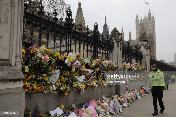 Flowers are left outside the Houses of Parliament in memory of those who died in last weeks Westminster terror attack on March 27 2017 in London...