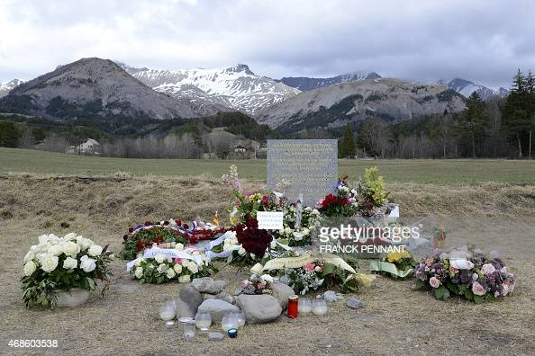 Flowers are pictured in front of a stela commemorating the victims of the March 24 Germanwings Airbus A320 crash in the village of Le Vernet prior to...