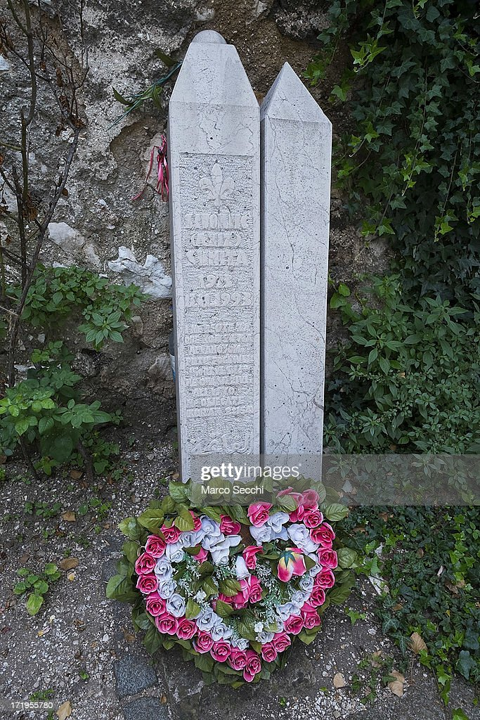 Flowers are place at the original thumbstone of a twenty year old girl killed during the 1993 siege as the city of Mostar remembers the 1993 conflict on June 28, 2013 in Mostar, Bosnia and Herzegovina. The Siege of Mostar peaked in 1993 during the Croat-Bosniak conflict lasting eighteen months as fighting took place as Bosnia and Herzegovina declared independence from Yugoslavia. The city was divided in half between the two battling armies. Mostar, dating back over four hundred years, was mostly destroyed through the fighting. Although reconstruction has slowly commenced in the last decades, evidence of the war remains in bullet ravaged buildings still standing throughout the city.