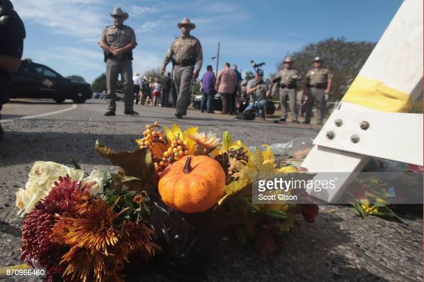 Flowers are placed at a police barricade near the First Baptist Church of Sutherland Springs on November 6 2017 in Sutherland Springs Texas Yesterday...