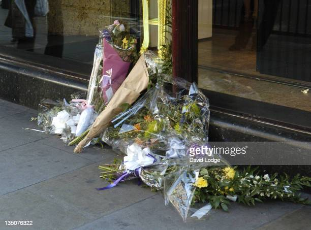 Flowers are placed at a tribute to Princess Diana and Dodi Fayed at Harrods to commemorate eight years since their deaths
