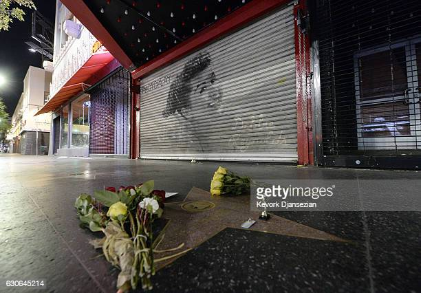 Flowers are placed Debbie Reynolds's film performance star on The Hollywood Walk of Fame on December 29 2016 in Hollywood California Reynolds has two...