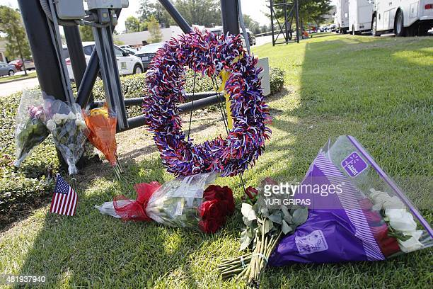 Flowers are placed outside The Grand Theatre on July 25 2015 in memory of victims of a July 23 2015 deadly shooting in Lafayette Louisiana The...