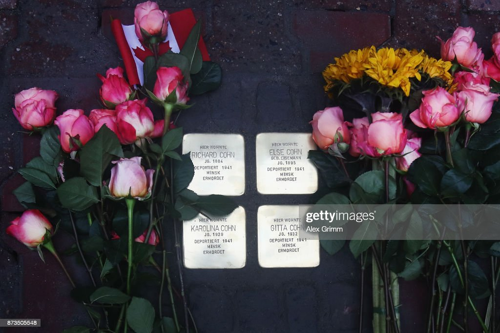 Flowers are put down next to the four 'stumbling stones' laid by German artist Gunter Demnig to commemorate Jewish schoolgirl and Holocaust victim Karolina Cohn and her family outside the building where they once lived on November 13, 2017 in Frankfurt, Germany. Karolina's fate came to light after Israeli archeologists digging at the former World War II Sobibor concentration camp found an amulet inscribed with Karolina's birthdate and birthplace, which helped them to confirm that she and her family were killed there. The Nazis deported Karolina, then 12, and her family to Minsk in 1941, though the rest of their journey had been unknown until now. Approximately 30 members of the Cohn family came from the United States, Israel, Japan and Canada to attend today's ceremonies. 'Stumbling stones,' in German called 'Stolpersteine,' are commemorative cobblestones affixed with a brass plate with the names of victims laid in the sidewalks outside the former residences of Jews in Germany killed in the Holocaust.