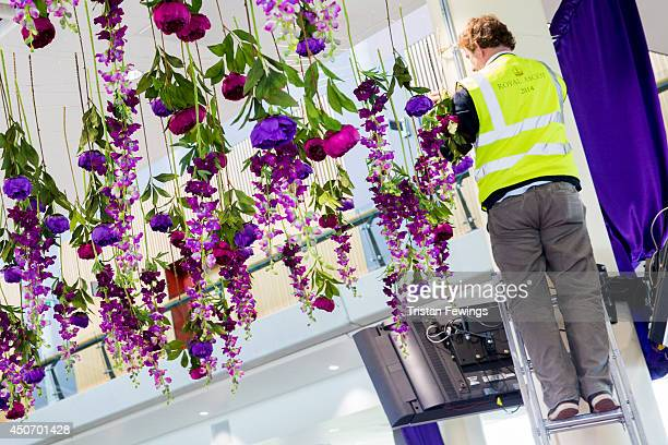 Flowers are put in place as the finishing touches are added ahead of Royal Ascot 2014 at Ascot Racecourse on June 16 2014 in Ascot England