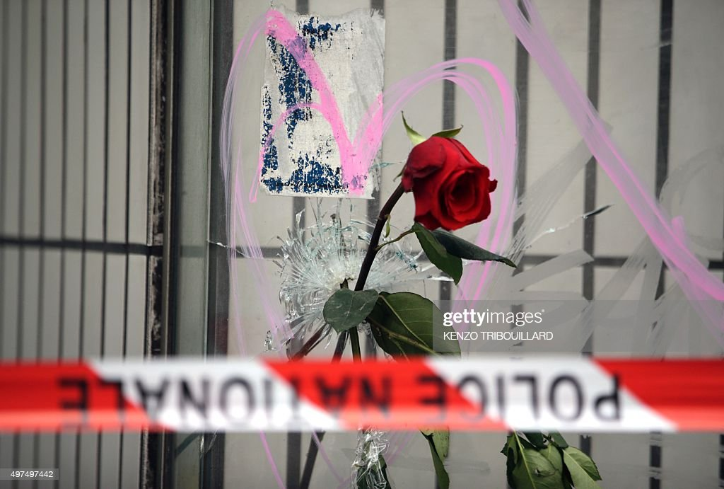 Flowers are put on bullet holes in the windows of the cafe 'A la Bonne Biere' on November 17 2015 in tribute to the victims of the Paris attacks...