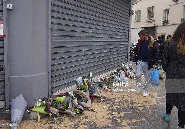 Flowers are seen at a corner in Bichat street in Paris France on November 14 2015 following the attacks that left at least 128 people dead and 250...