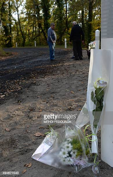 Flowers are seen at the site of the October 23 accident in which at least 43 people were killed when a coach collided with a lorry and caught fire in...
