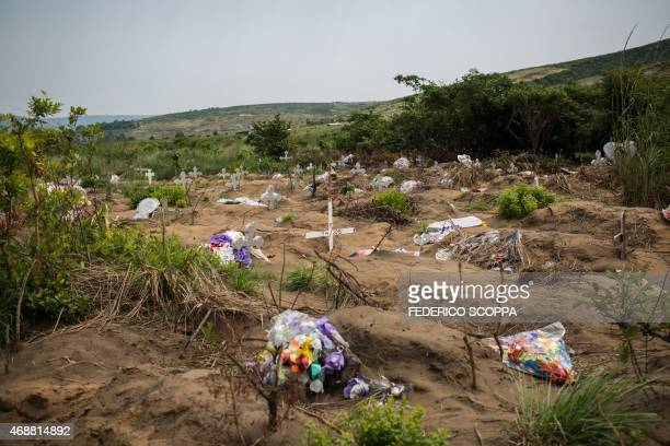 Flowers are seen on April 7 2015 at the Maluku cemetery about 100 kms from Kinshasa A rights group and an opposition lawmaker called on April 7 on...